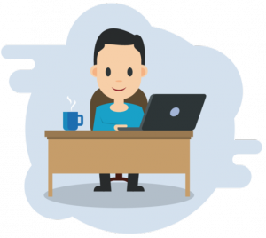 Man Sat At Desk With Laptop