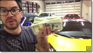 Tai Lopez Holding Money In His Garage